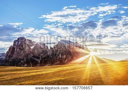 Alpe di Siusi, mountain ridge in Dolomites mountains. Italy, alpine region South Tyrol, ski resort. Beautiful sunrising scene in Alps. Sunrise time.