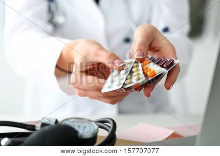 Female Doctor Hand Holding Pack Of Different Tablet Blisters