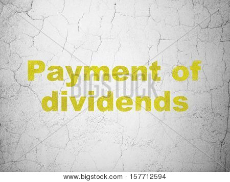 Money concept: Yellow Payment Of Dividends on textured concrete wall background