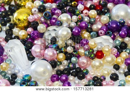 Colorful plastic beads in Detail as Background