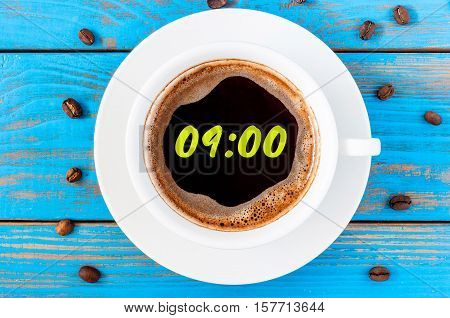 Nine hours or 9:00 on morning cup of coffee like a round clock face. Top view.