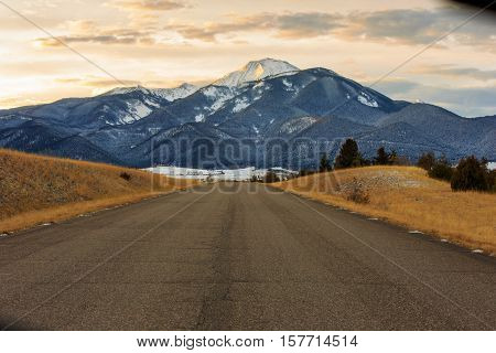 Lanscape scene of large mountain with snow covered peak.
