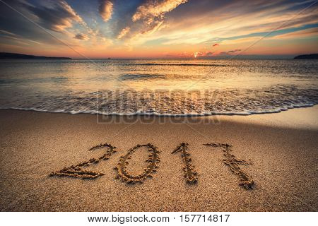 Happy New Year 2017 Concept On The Sea Beach At Sunrise