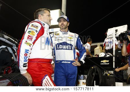 Homestead, FL - Nov 18, 2016: Tony Stewart (14) and Jimmie Johnson (48) hang out on pit road prior to qualifying for the Ford EcoBoost 400 at the Homestead-Miami Speedway in Homestead, FL.
