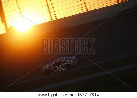 Homestead, FL - Nov 20, 2016: The sun sets during  the Ford EcoBoost 400 at the Homestead-Miami Speedway in Homestead, FL.