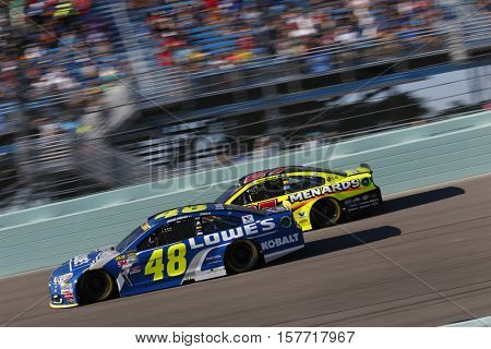 Homestead, FL - Nov 20, 2016: Jimmie Johnson (48) battles for position during the Ford EcoBoost 400 at the Homestead-Miami Speedway in Homestead, FL.