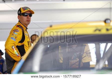 Homestead, FL - Nov 19, 2016: Kyle Busch (18) hangs out in the garage during practice for the Ford EcoBoost 400 at the Homestead-Miami Speedway in Homestead, FL.