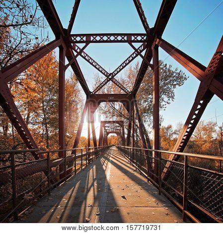 an old antique train trestle bridge that no longer has tracks