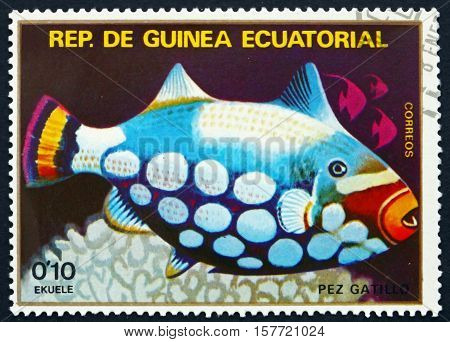 EQUATORIAL GUINEA - CIRCA 1979: a stamp printed in Equatorial Guinea shows Clown Triggerfish Balistoides Conspicillum Fish circa 1979