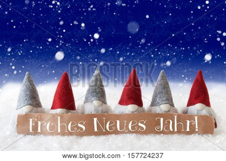 Label With German Text Frohes Neues Jahr Means Happy New Year. Christmas Greeting Card With Gnomes. Blue Background With Snowflakes