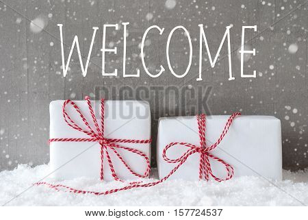 English Text Welcome. Two White Christmas Gifts Or Presents On Snow. Cement Wall As Background With Snowflakes. Modern And Urban Style. Card For Birthday Or Seasons Greetings.