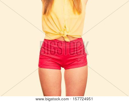 Slim Girl Wearing Red Summer Shorts.