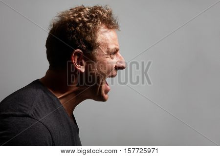 Angry man profile face