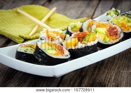 various fish sushi plate on wooden table