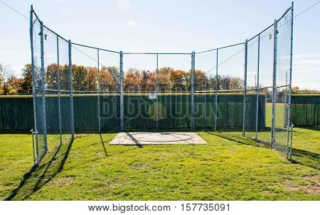 Fenced in discus cage for high school athletics