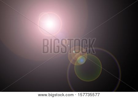Sun light effect on the black color background.