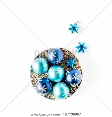 round box with bright blue christmas balls on white background. flat lay top view