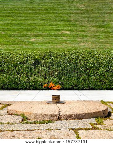 The Eternal Flame next to the John F. Kennedy grave at Arlington National Cemetery near Washington D.C.