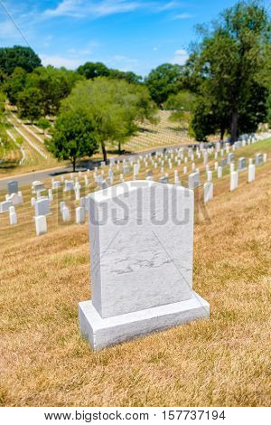 Tombstones on a grassy hill at Arlington National Cemetery near Washington D.C.