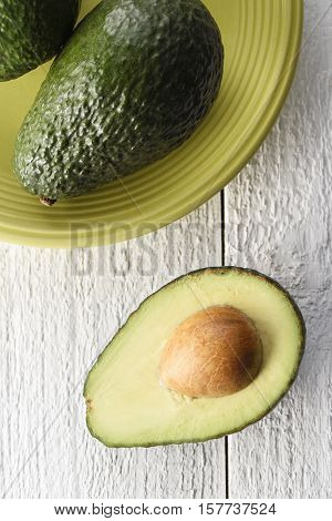 Freshly sliced avocado on a white background