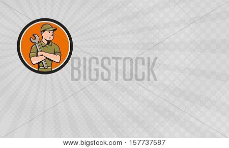 Business card showing Illustration of a mechanic worker wearing hat arms crossed holding spanner looking to the side viewed from front set inside circle done in cartoon style.