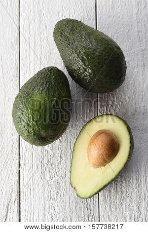 Freshly sliced avocado on a white background