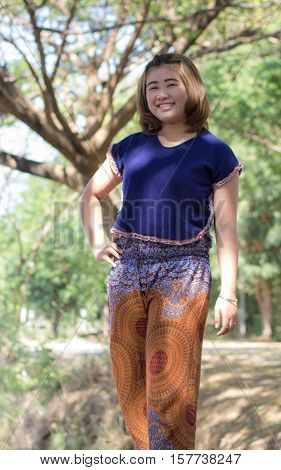 Beautiful young asia woman with tree thailand