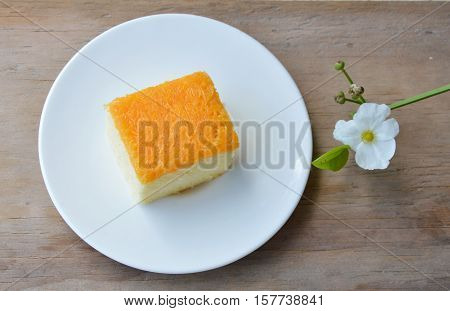 butter cake topping golden egg strips on dish