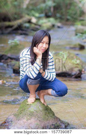 Portrait thai woman in river , asian