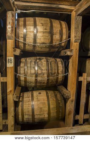 Bourbon barrels aging in rik house warehouse.