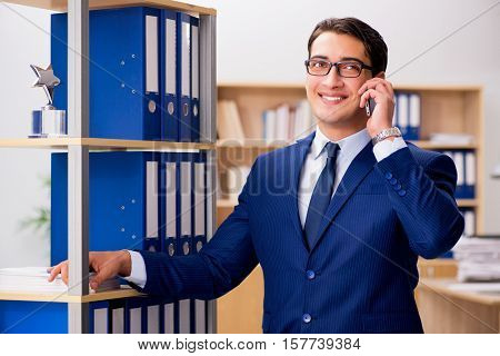 Handsome businessman speaking on mobile phone