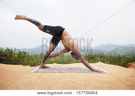 Tattooed Man Yoga Outdoors Concept