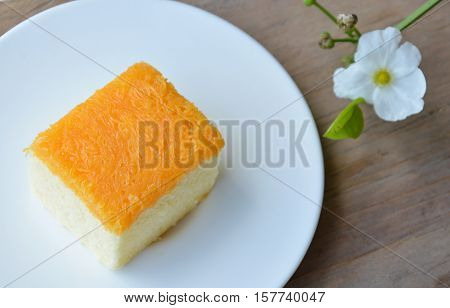 butter cake topping golden threads on dish