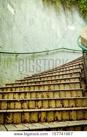 Architecture high stairway in the park, stone stairway, stairway, Stone spiral staircase with flowers in modern design.