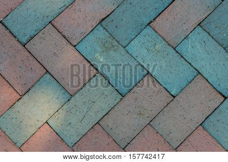 Chevron Brick Pattern on Pedestrian Walkway Background