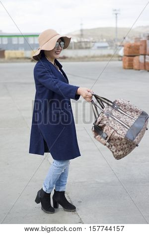 The Girl Of Asian Appearance Demonstrates A New Trend In The Fashion World.