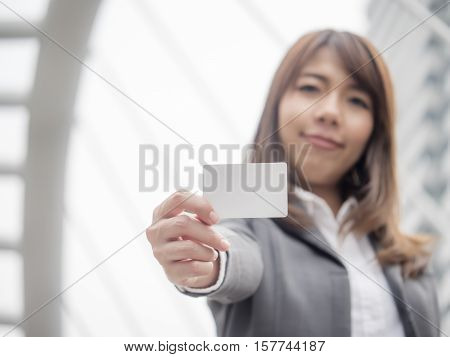 selective focus of Asian woman holding blank card