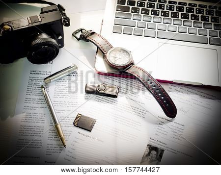 Close up of modern working table of businessman with notebook paper pen watch on white table with copy space