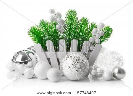 Christmas tree with white balls decoration in wooden basket. Holiday greeting card. Isolated on background