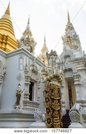 angel statue with Pagoda in Wat Sri Don Moon , Chiangmai Thailand