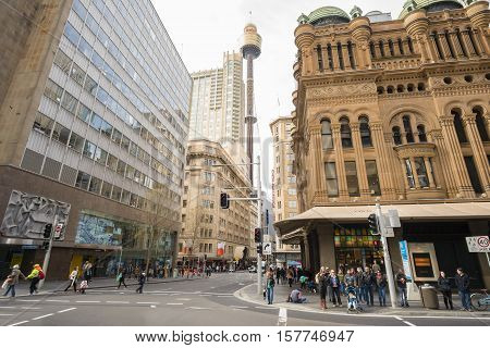 Sydney, Australia - June 26, 2016: View of one of the busiest streets in Sydney with the historical Queen Victoria building, Sydney Tower and modern buildings.