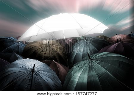 Umbrella Lights Glowing Standing Out From Crowd Of Dark Umbrella, Business, Leadership Concept, Bein