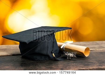 Graduation Cap, Hat With Degree Paper On Wood Table, Abstract Light Background Empty Ready For Your