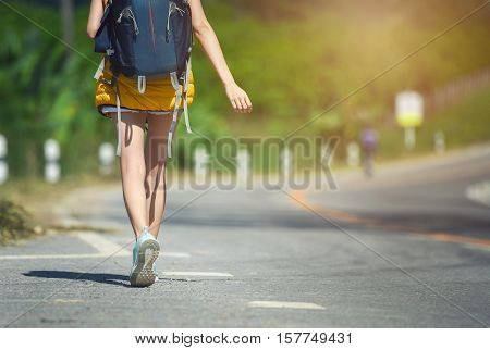 women with backpack walking on street, concept of journey travel or sport background