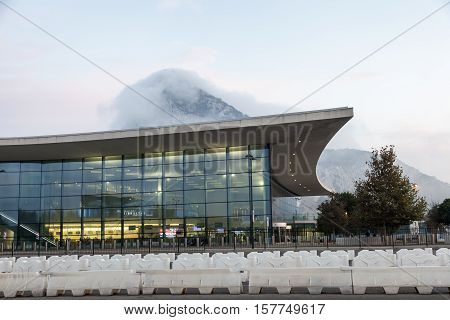 GIBRALTAR UK - OCT 20 2016: New modern terminal building of the Gibraltar International Airport illuminated at dusk