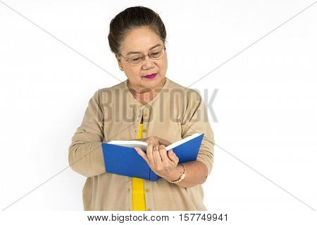 Senior Adult Woman Book Reading Retirement Portrait Concept