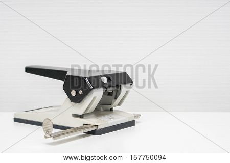 isolated paper punch in office with white background