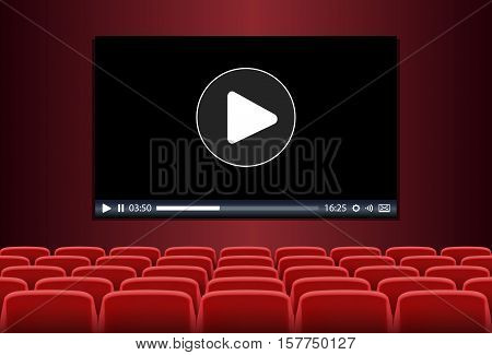 Rows of red seats in front of multimedia playing on a screen