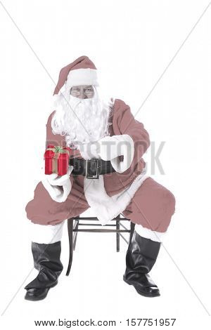Santa Claus is SHOCKED and AMAZED at what he sees inside a velvet red Christmas present box given to him by his elves as a Christmas Present to him. with room for your text.