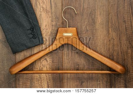 Coat Hanger With Suit On Wood Board Laundry Shop Business Concept.